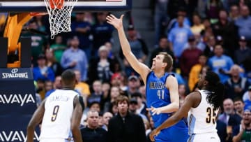 Mar 28, 2016; Denver, CO, USA; Dallas Mavericks forward Dirk Nowitzki (41) takes a shot against Denver Nuggets forward Kenneth Faried (35) and guard JaKarr Sampson (9) in the first quarter at the Pepsi Center. Mandatory Credit: Isaiah J. Downing-USA TODAY Sports