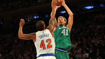 Dec 7, 2015; New York, NY, USA; Dallas Mavericks forward Dirk Nowitzki (41) shoots over New York Knicks forward Lance Thomas (42) during the second quarter at Madison Square Garden. Mandatory Credit: Anthony Gruppuso-USA TODAY Sports