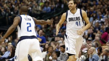 Mar 18, 2016; Dallas, TX, USA; Dallas Mavericks forward Dirk Nowitzki (41) celebrates scoring a basket with guard Raymond Felton (2) in the second half against the Golden State Warriors at American Airlines Center. Golden State won 130-112. Mandatory Credit: Tim Heitman-USA TODAY Sports