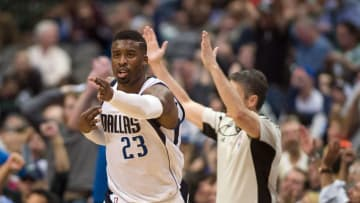 Mar 30, 2016; Dallas, TX, USA; Dallas Mavericks guard Wesley Matthews (23) celebrates making a three point basket against the New York Knicks during the second half at the American Airlines Center. The Mavericks defeat the Knicks 91-89. Mandatory Credit: Jerome Miron-USA TODAY Sports