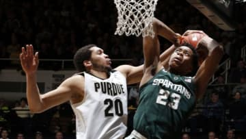 Feb 9, 2016; West Lafayette, IN, USA; Michigan State Spartans forward Deyonta Davis (23) has his shot blocked by Purdue Boilermakers center A.J. Hammons (20) at Mackey Arena. Purdue defeats Michigan State 82-81 in overtime. Mandatory Credit: Brian Spurlock-USA TODAY Sports