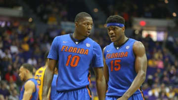 Feb 27, 2016; Baton Rouge, LA, USA; Florida Gators forward Dorian Finney-Smith (10) and center John Egbunu (15) in the second half of their game against the LSU Tigers at the Pete Maravich Assembly Center. Mandatory Credit: Chuck Cook-USA TODAY Sports