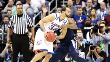 Mar 26, 2016; Louisville, KY, USA; Kansas Jayhawks forward Perry Ellis (34) drives to the basket against Villanova Wildcats forward Kris Jenkins (2) during the first half of the south regional final of the NCAA Tournament at KFC YUM!. Mandatory Credit: Aaron Doster-USA TODAY Sports