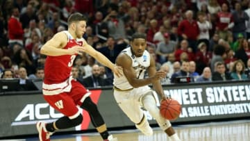 Mar 25, 2016; Philadelphia, PA, USA; Notre Dame Fighting Irish guard Demetrius Jackson (11) drives against Wisconsin Badgers guard Zak Showalter (3) during the second half in a semifinal game in the East regional of the NCAA Tournament at Wells Fargo Center. Mandatory Credit: Bill Streicher-USA TODAY Sports