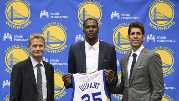 Jul 7, 2016; Oakland, CA, USA; Golden State Warriors head coach Steve Kerr (left), Kevin Durant (center), and general manager Bob Myers (right) pose for a photo during a press conference after Durant signed with the Warriors at the Warriors Practice Facility. Mandatory Credit: Kyle Terada-USA TODAY Sports