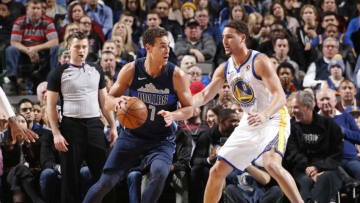 DALLAS, TX - JANUARY 3: Dwight Powell #7 of the Dallas Mavericks handles the ball during the game against the Golden State Warriors on January 3, 2018 at the American Airlines Center in Dallas, Texas. NOTE TO USER: User expressly acknowledges and agrees that, by downloading and or using this photograph, User is consenting to the terms and conditions of the Getty Images License Agreement. Mandatory Copyright Notice: Copyright 2018 NBAE (Photo by Glenn James/NBAE via Getty Images)