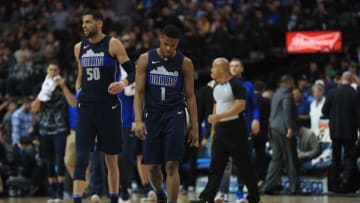 DALLAS, TX - JANUARY 13: Dennis Smith Jr. #1 of the Dallas Mavericks walks off the court during play against the Los Angeles Lakers at American Airlines Center on January 13, 2018 in Dallas, Texas. NOTE TO USER: User expressly acknowledges and agrees that, by downloading and or using this photograph, User is consenting to the terms and conditions of the Getty Images License Agreement. (Photo by Ronald Martinez/Getty Images)