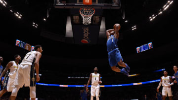 DENVER, CO - JANUARY 16 : Dennis Smith Jr. #1 of the Dallas Mavericks drives to the basket during the game against the Denver Nuggets on January 16, 2018 at the Pepsi Center in Denver, Colorado. NOTE TO USER: User expressly acknowledges and agrees that, by downloading and/or using this photograph, user is consenting to the terms and conditions of the Getty Images License Agreement. Mandatory Copyright Notice: Copyright 2018 NBAE (Photo by Garrett Ellwood/NBAE via Getty Images)