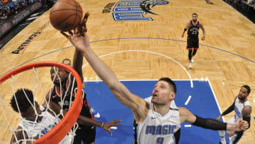 ORLANDO, FL - DECEMBER 28: Nikola Vucevic #9 of the Orlando Magic and Serge Ibaka #9 of the Toronto Raptors reach for the rebound during the game on December 28, 2018 at Amway Center in Orlando, Florida. NOTE TO USER: User expressly acknowledges and agrees that, by downloading and or using this photograph, User is consenting to the terms and conditions of the Getty Images License Agreement. Mandatory Copyright Notice: Copyright 2018 NBAE (Photo by Fernando Medina/NBAE via Getty Images)