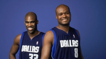 DALLAS - APRIL 22: Antawn Jamison #33 and Antoine Walker #8 of the Dallas Mavericks pose for a portrait on April 22, 2004 in Dallas, Texas. NOTE TO USER: User expressly acknowledges and agrees that, by downloading and/or using this Photograph, User is consenting to the terms and conditions of the Getty Images License Agreement. (Photo by Jennifer Pottheiser/NBAE via Getty Images)