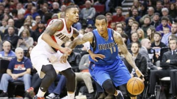 PORTLAND, OR - DECEMBER 7: Dallas Mavericks shooting guard Monta Ellis (11) drives past Portland Trail Blazers point guard Damian Lillard (0) during the Dallas Mavericks 108-106 victory over the Portland Trail Blazers at the Moda Center on December 7, 2013 in Portland, Oregon. NOTE TO USER: User expressly acknowledges and agrees that, by downloading and or using this photograph, User is consenting to the terms and conditions of the Getty Images License Agreement. (Photo by Chris Elise/Getty Images)
