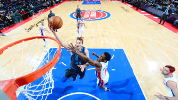 DETROIT, MI - JANUARY 31: Ryan Broekhoff #45 of the Dallas Mavericks drives to the basket during the game against Langston Galloway #9 of the Detroit Pistons on January 31, 2019 at Little Caesars Arena in Detroit, Michigan. NOTE TO USER: User expressly acknowledges and agrees that, by downloading and/or using this photograph, User is consenting to the terms and conditions of the Getty Images License Agreement. Mandatory Copyright Notice: Copyright 2019 NBAE (Photo by Chris Schwegler/NBAE via Getty Images)