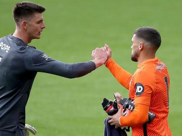 Burnley's Nick Pope embraces Brighton goalkeeper Mat Ryan