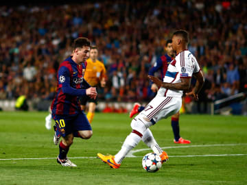 Lionel Messi puts Jerome Boateng on his backside at the Camp Nou