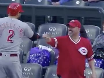 Nick Castellanos fist bumps a Reds fan in Denver.
