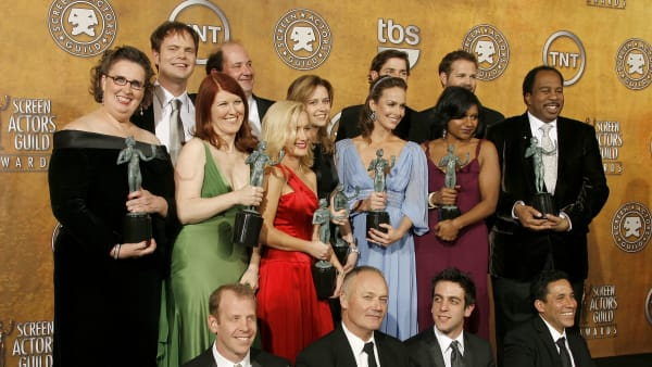 """LOS ANGELES, CA - JANUARY 28:  (L-R top) Actors Phyllis Smith, Kate Flannery, Angela Kinsey, Rainn Wilson, Brian Baumgartner, Jenna Fischer, Melora Hardin, John Krasinski, Mindy Kaling, David Denman, Leslie David Baker, (L-R bottom) Paul Lieberstein, Creed Bratton, writer/actor B.J. Novak and actor Oscar Nunez, winners of the """"Ensemble In A Comedy Series"""" award for """"The Office"""" pose in the press room during the 13th Annual Screen Actors Guild Awards held at the Shrine Auditorium on January 28, 2007 in Los Angeles, California.  (Photo by Vince Bucci/Getty Images)"""