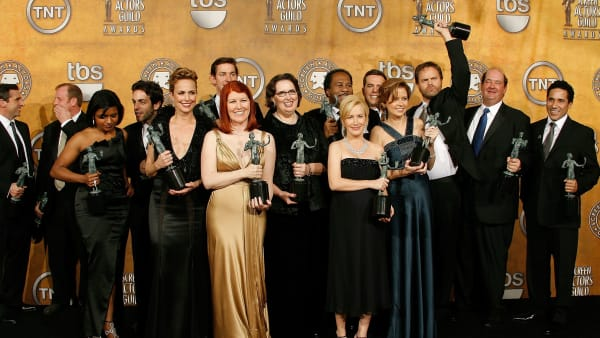 """LOS ANGELES - JANUARY 27:  (L-R) Steve Carell, Paul Lieberstein, Mindy Kaling, B.J. Novak, Melora Hardin, Kate Flannery, Phyllis Smith, Angela Kinsey, Jenna Fischer, Rainn Wilson, Brian Baumgartner and Oscar Nunez pose with the Outstanding Performance by an Ensemble in a Comedy Series for """"The Office"""" in the press room during the 14th annual Screen Actors Guild awards held at the Shrine Auditorium on January 27, 2008 in Los Angeles, California.  (Photo by Vince Bucci/Getty Images)"""