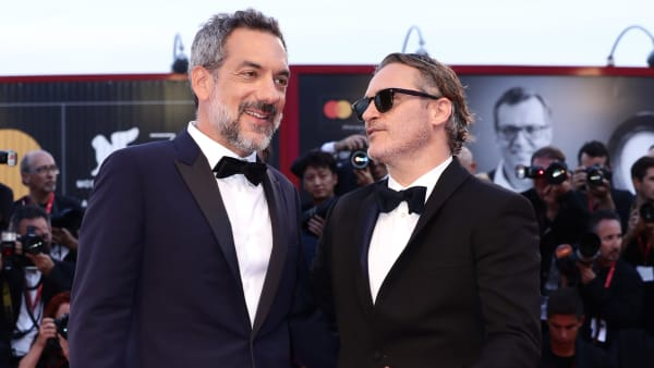 """VENICE, ITALY - AUGUST 31: Joaquin Phoenix and Director Todd Phillips walk the red carpet ahead of the """"Joker"""" screening during the 76th Venice Film Festival at Sala Grande on August 31, 2019 in Venice, Italy. (Photo by Vittorio Zunino Celotto/Getty Images)"""