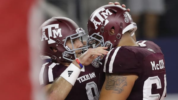 ARLINGTON, TX - SEPTEMBER 24:  Trevor Knight #8 of the Texas A&M Aggies celebrates his touchdown with Erik McCoy #64 against the Arkansas Razorbacks in the second quarter at AT&T Stadium on September 24, 2016 in Arlington, Texas.  (Photo by Ronald Martinez/Getty Images)