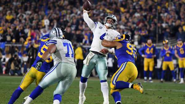 LOS ANGELES, CA - JANUARY 12:  Dak Prescott #4 of the Dallas Cowboys passes in the fourth quarter against Ndamukong Suh #93 of the Los Angeles Rams in the NFC Divisional Playoff game at Los Angeles Memorial Coliseum on January 12, 2019 in Los Angeles, California.  (Photo by Harry How/Getty Images)