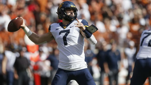 AUSTIN, TX - NOVEMBER 03:  Will Grier #7 of the West Virginia Mountaineers looks to pass in the first quarter against the Texas Longhorns at Darrell K Royal-Texas Memorial Stadium on November 3, 2018 in Austin, Texas.  (Photo by Tim Warner/Getty Images)