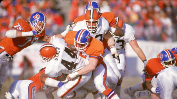DENVER, CO - JANUARY 17:  Linebacker Karl Mecklenburg #77 of the Denver Broncos stops running back Earnest Byner #44 of the Cleveland Browns in the 1987 AFC Championship Game at Mile High Stadium on January 17, 1988 in Denver, Colorado. The Broncos defeated the Browns 38-33. (Photo by E.L. Bakke/Getty Images)