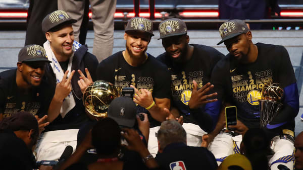 CLEVELAND, OH - JUNE 08:  Andre Iguodala #9, Klay Thompson #11, Stephen Curry #30, Draymond Green #23 and Kevin Durant #35 of the Golden State Warriors celebrate after defeating the Cleveland Cavaliers during Game Four of the 2018 NBA Finals at Quicken Loans Arena on June 8, 2018 in Cleveland, Ohio. The Warriors defeated the Cavaliers 108-85 to win the 2018 NBA Finals. NOTE TO USER: User expressly acknowledges and agrees that, by downloading and or using this photograph, User is consenting to the terms and conditions of the Getty Images License Agreement.  (Photo by Justin K. Aller/Getty Images)