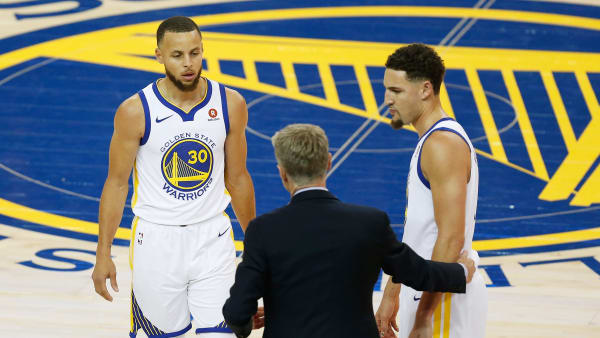 OAKLAND, CA - MAY 31:  Stephen Curry #30 and Klay Thompson #11 talk to head coach Steve Kerr of the Golden State Warriors in Game 1 of the 2018 NBA Finals against the Cleveland Cavaliers at ORACLE Arena on May 31, 2018 in Oakland, California. NOTE TO USER: User expressly acknowledges and agrees that, by downloading and or using this photograph, User is consenting to the terms and conditions of the Getty Images License Agreement.  (Photo by Lachlan Cunningham/Getty Images)