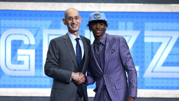 NEW YORK, NEW YORK - JUNE 20: Ja Morant poses with NBA Commissioner Adam Silver after being drafted with the second overall pick by the Memphis Grizzlies during the 2019 NBA Draft at the Barclays Center on June 20, 2019 in the Brooklyn borough of New York City. NOTE TO USER: User expressly acknowledges and agrees that, by downloading and or using this photograph, User is consenting to the terms and conditions of the Getty Images License Agreement. (Photo by Sarah Stier/Getty Images)