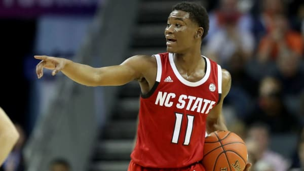 CHARLOTTE, NORTH CAROLINA - MARCH 14: Markell Johnson #11 of the North Carolina State Wolfpack reacts against the Virginia Cavaliers during their game in the quarterfinal round of the 2019 Men's ACC Basketball Tournament at Spectrum Center on March 14, 2019 in Charlotte, North Carolina. (Photo by Streeter Lecka/Getty Images)