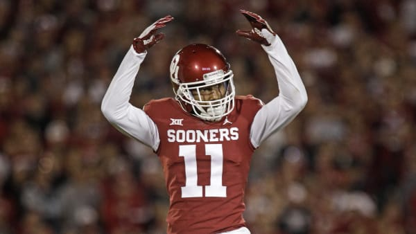 NORMAN, OK - SEPTEMBER 22: Cornerback Parnell Motley #11 of the Oklahoma Sooners waves to the crowd during the game against the Army Black Knights at Gaylord Family Oklahoma Memorial Stadium on September 22, 2018 in Norman, Oklahoma. The Sooners defeated the Black Knights 28-21 in overtime. (Photo by Brett Deering/Getty Images)