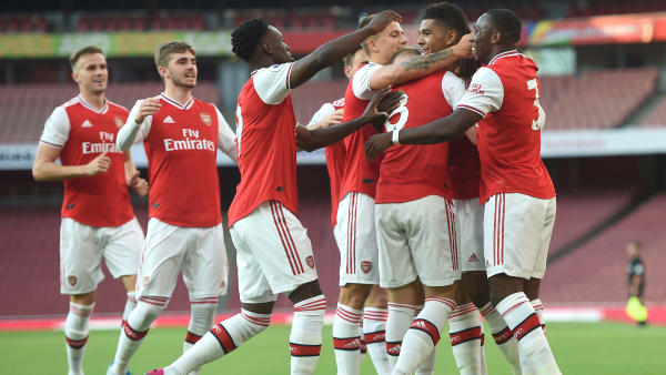 LONDON, ENGLAND - AUGUST 23: Tyreece John-Jules of Arsenal celebrates with teammates after scoring his team's first goal during the Premier League 2 match between Arsenal and Everton at Emirates Stadium on August 23, 2019 in London, England. (Photo by Harriet Lander/Getty Images)