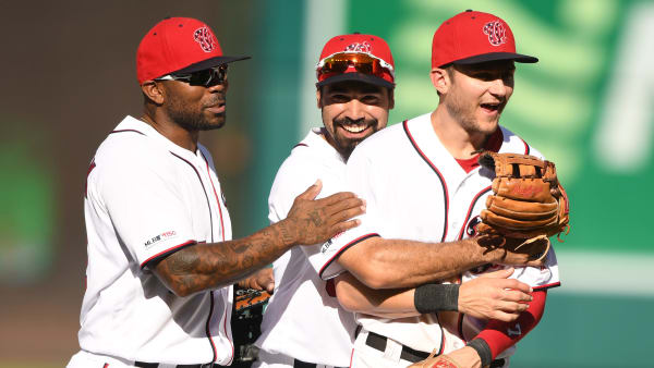 WASHINGTON, DC - SEPTEMBER 15:  Howie Kendrick #47, Anthony Rendon #6 and Trea Turner #7 of the Washington Nationals celebrate a win after a baseball game against the Atlanta Braves at Nationals Park on September 15, 2019 in Washington, DC.  (Photo by Mitchell Layton/Getty Images)