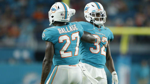 MIAMI, FLORIDA - AUGUST 08:  Kalen Ballage #27 of the Miami Dolphins celebrates with Kenyan Drake #32 after scoring a touchdown against the Atlanta Falcons during the first quarter of the preseason game at Hard Rock Stadium on August 08, 2019 in Miami, Florida. (Photo by Michael Reaves/Getty Images)