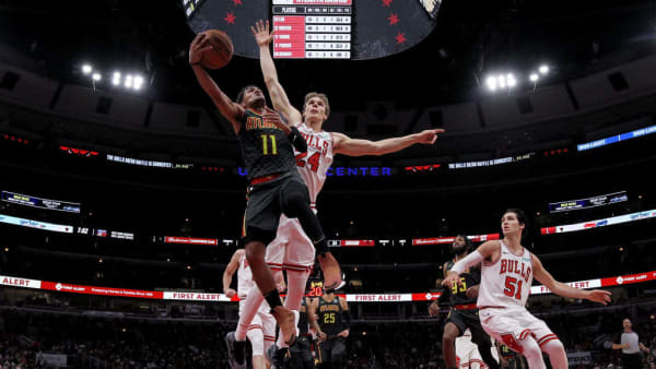 CHICAGO, ILLINOIS - OCTOBER 17: Trae Young #11 of the Atlanta Hawks attempts a shot while being guarded by Lauri Markkanen #24 of the Chicago Bulls in the second quarter during a preseason game at the United Center on October 17, 2019 in Chicago, Illinois. NOTE TO USER: User expressly acknowledges and agrees that, by downloading and/or using this photograph, user is consenting to the terms and conditions of the Getty Images License Agreement. (Photo by Dylan Buell/Getty Images)