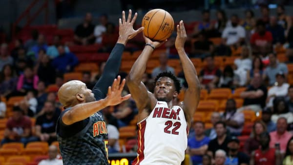 MIAMI, FLORIDA - OCTOBER 14:  Jimmy Butler #22 of the Miami Heat shoots a jumper over Vince Carter #15 of the Atlanta Hawks during the second half of the preseason game at American Airlines Arena on October 14, 2019 in Miami, Florida. NOTE TO USER: User expressly acknowledges and agrees that, by downloading and or using this photograph, User is consenting to the terms and conditions of the Getty Images License Agreement.  (Photo by Michael Reaves/Getty Images)