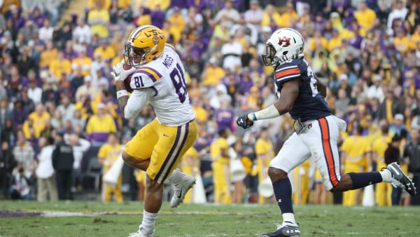 BATON ROUGE, LOUISIANA - OCTOBER 26: Thaddeus Moss #81 of the LSU Tigers makes a catch against Jeremiah Dinson #20 of the Auburn Tigers during the first half at Tiger Stadium on October 26, 2019 in Baton Rouge, Louisiana. (Photo by Chris Graythen/Getty Images)