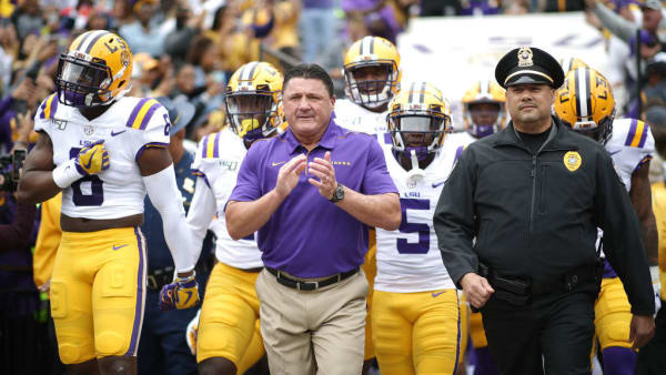 BATON ROUGE, LOUISIANA - OCTOBER 26: Head coach Ed Orgeron of the LSU Tigers leads the team on to the field against the Auburn Tigers prior to the game at Tiger Stadium on October 26, 2019 in Baton Rouge, Louisiana. (Photo by Chris Graythen/Getty Images)