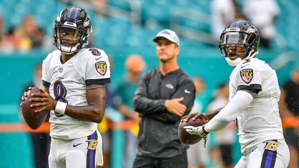 MIAMI, FL - AUGUST 25: Lamar Jackson #8 and Robert Griffin III #3 of the Baltimore Ravens warm up in front of head coach John Harbaugh of the Baltimore Ravens before a preseason game against the Miami Dolphins at Hard Rock Stadium on August 25, 2018 in Miami, Florida. (Photo by Mark Brown/Getty Images)