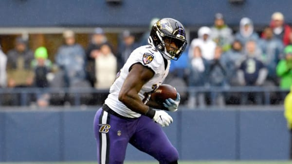 SEATTLE, WASHINGTON - OCTOBER 20: Gus Edwards #35 of the Baltimore Ravens runs the ball during the game against the Seattle Seahawks at CenturyLink Field on October 20, 2019 in Seattle, Washington. The Baltimore Ravens top the Seattle Seahawks 30-16. (Photo by Alika Jenner/Getty Images)