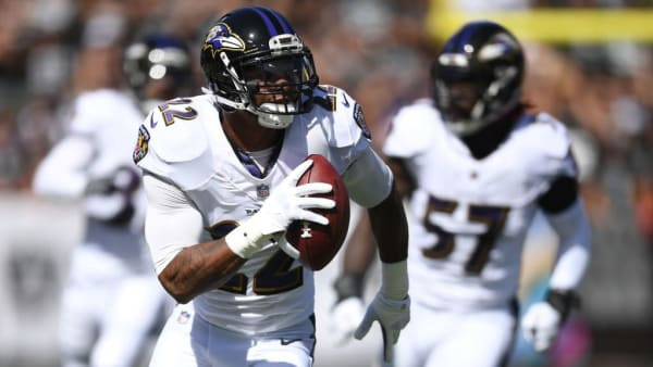 Jimmy Smith runs after intercepting a pass against the Raiders.