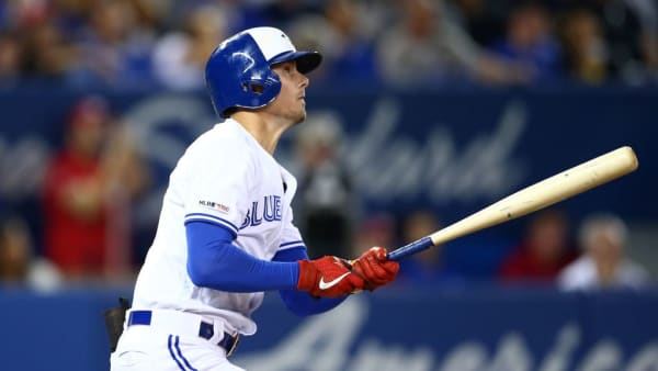 TORONTO, ON - SEPTEMBER 10:  Cavan Biggio #8 of the Toronto Blue Jays hits a home run in the third inning during a MLB game against the Boston Red Sox at Rogers Centre on September 10, 2019 in Toronto, Canada.  (Photo by Vaughn Ridley/Getty Images)