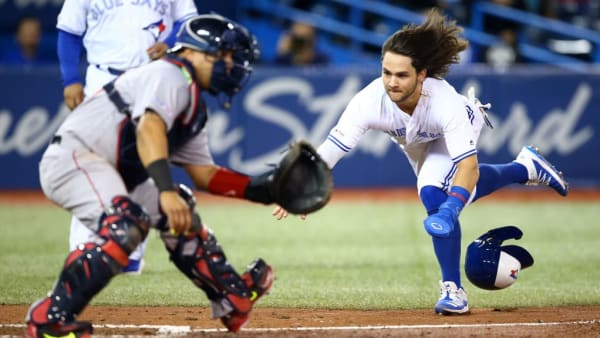 TORONTO, ON - SEPTEMBER 12:  Bo Bichette #11 of the Toronto Blue Jays scores a run on a triple by Cavan Biggio #8 in the fifth inning during a MLB game against the Boston Red Sox at Rogers Centre on September 12, 2019 in Toronto, Canada.  (Photo by Vaughn Ridley/Getty Images)