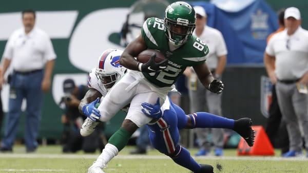 EAST RUTHERFORD, NEW JERSEY - SEPTEMBER 08: Jamison Crowder #82 of the New York Jets is tied up by Siran Neal #33 of the Buffalo Bills during the at MetLife Stadium on September 08, 2019 in East Rutherford, New Jersey. (Photo by Michael Owens/Getty Images)