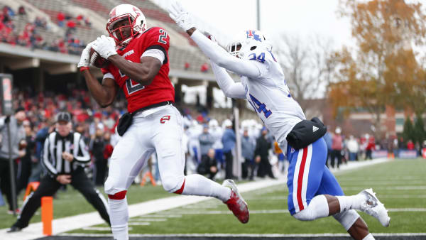 BOWLING GREEN, KY - DECEMBER 03: Taywan Taylor #2 of the Western Kentucky Hilltoppers catches the ball in the end zone for a touchdown as L'Jarius Sneed #24 of the Louisiana Tech Bulldogs defends at Houchens-Smith Stadium on December 3, 2016 in Champaign, Illinois. (Photo by Michael Hickey/Getty Images)