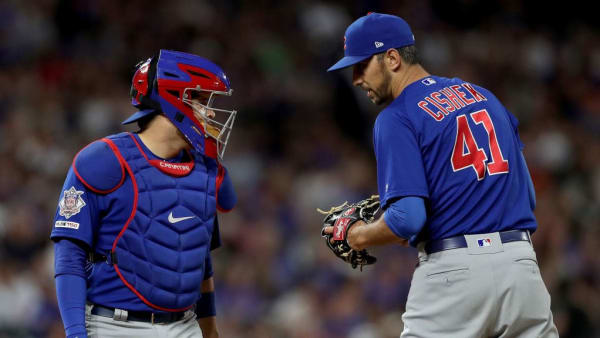 DENVER, COLORADO - JUNE 10: Catcher Victor Caratini #7 and  Steve Cishek #41 of the Chicago Cubs confer in the eighth inning against the Colorado Rockies at Coors Field on June 10, 2019 in Denver, Colorado. (Photo by Matthew Stockman/Getty Images)
