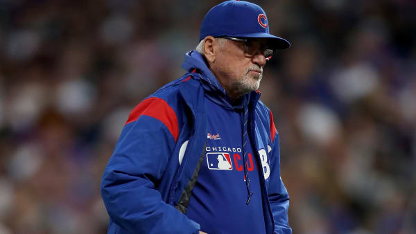 DENVER, COLORADO - JUNE 11: Manager Joe Maddon #70 of the Chicago Cubs returns to the dugout after changing pitchers in the fifth inning against the Colorado Rockies at Coors Field on June 11, 2019 in Denver, Colorado. (Photo by Matthew Stockman/Getty Images)