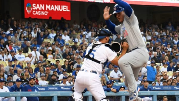 LOS ANGELES, CA - JUNE 13: Anthony Rizzo #44 of the Chicago Cubs is tagged out by catcher Austin Barnes #15 of the Los Angeles Dodgers during the first inning at Dodger Stadium on June 13, 2019 in Los Angeles, California. (Photo by Kevork Djansezian/Getty Images)