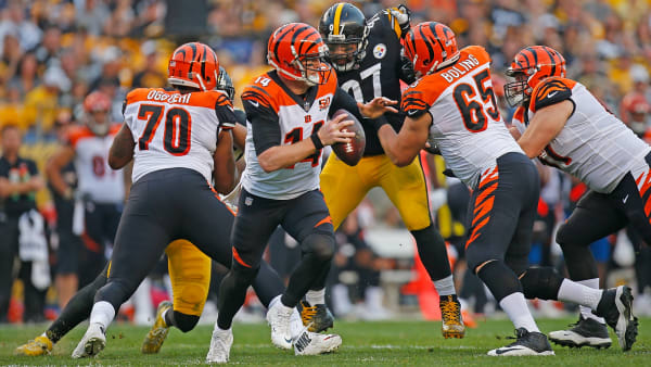 PITTSBURGH, PA - OCTOBER 22: Andy Dalton #14 of the Cincinnati Bengals scrambles out of the pocket in the first half during the game against the Pittsburgh Steelers at Heinz Field on October 22, 2017 in Pittsburgh, Pennsylvania. (Photo by Justin K. Aller/Getty Images)