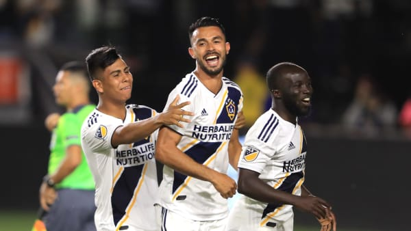 CARSON, CALIFORNIA - JULY 23:  Giancarlo Gonzalez #21 is congratulated by Efrain Alvarez #26 and Ema Boateng #24 of Los Angeles Galaxy after scoring the winning penatly shot during the quarterfinal match against  Tijuana of the 2019 Leagues Cup at Dignity Health Sports Park on July 23, 2019 in Carson, California. (Photo by Sean M. Haffey/Getty Images)